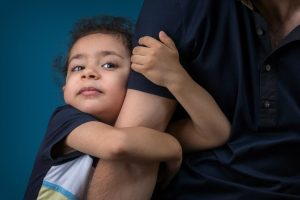 Child holding fathers arm